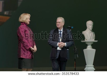 ST. PETERSBURG, RUSSIA - DECEMBER 16, 2015: Director of the Hermitage Museum Mikhail Piotrovsky (center) presenting awards during the closing ceremony of St. Petersburg International Cultural Forum - stock photo