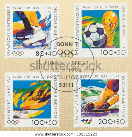 ST. PETERSBURG, RUSSIA - FEB 24, 2016: A first day of issue postmark printed in Bonn, Germany, shows Figure Skating, Soccer ball, Olympic Flame, World Cup Trophy, Skiier, circa 1994 - stock photo