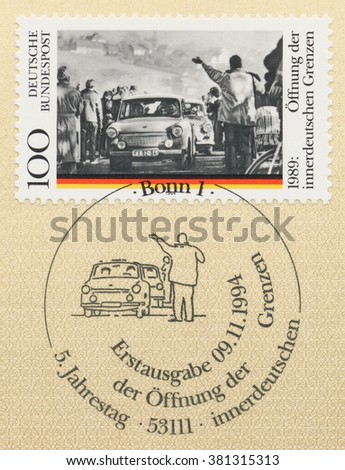 ST. PETERSBURG, RUSSIA - FEB 24, 2016: A first day of issue postmark printed in Bonn, Germany, shows Cars, Opening of the Berlin Wall, 5th Anniversary, circa 1994 - stock photo