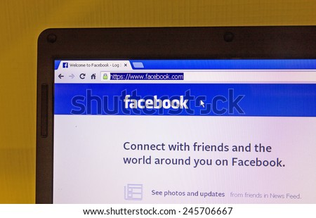 St. Petersburg, Russia-January 14, 2014: Photo Facebook home page on the screen. Is one of the most popular websites in the world. - stock photo