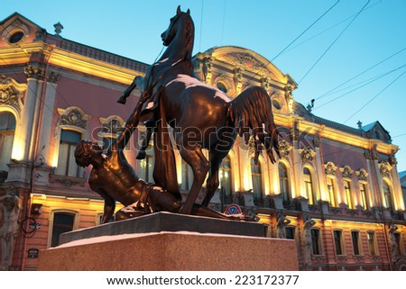 ST. PETERSBURG, RUSSIA - JANUARY 17, 2013: Sculpture at the Anichkov Bridge against Belosselsky-Belozersky Palace. The palace is under restoration till October 2013 after the fire of February 28, 2012 - stock photo