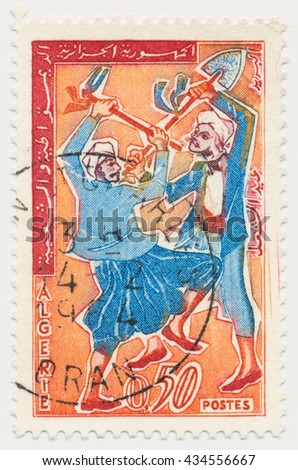 ST. PETERSBURG, RUSSIA - JUNE 8, 2016: A postmark printed in Algeria, shows A peasant with a hoe and a shovel, circa 1963 - stock photo