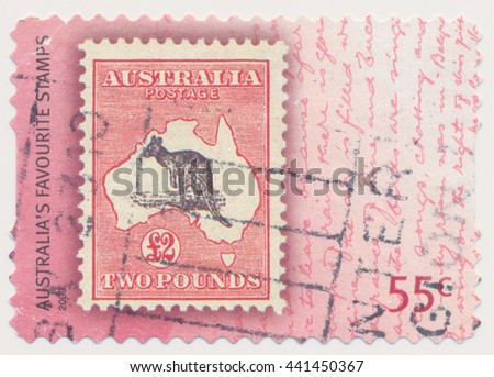 ST. PETERSBURG, RUSSIA - JUNE 22, 2016: A postmark printed in Australia, shows kangaroo and map Australia (1913), series old postage stamp on a new, circa 2009 - stock photo