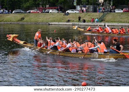 ST. PETERSBURG, RUSSIA - JUNE 12, 2015: Competition of Dragon boats during the Golden Blades Regatta. This kind of competitions make the race accessible for not only professional athletes but amateurs - stock photo