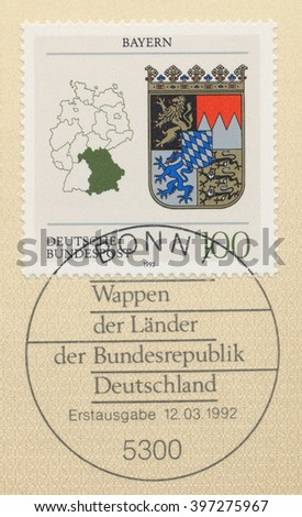 ST. PETERSBURG, RUSSIA - MAR 28, 2016: A first day of issue postmark printed in Bonn, Germany, shows Coats of Arms Bavaria and map of States of the Federal Republic of Germany, circa 1992 - stock photo