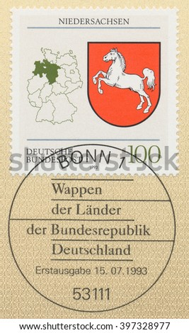 ST. PETERSBURG, RUSSIA - MAR 28, 2016: A first day of issue postmark printed in Bonn, Germany, shows Coats of Arms  Lower Saxony and map of States of the Federal Republic of Germany, circa 1993 - stock photo