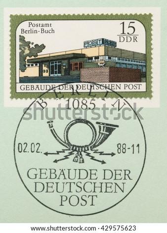 ST. PETERSBURG, RUSSIA - MAY 31, 2016: A postmark printed in DDR, shows Berlin-Buch post office, series Postal Buildings, East Berlin, circa 1988 - stock photo