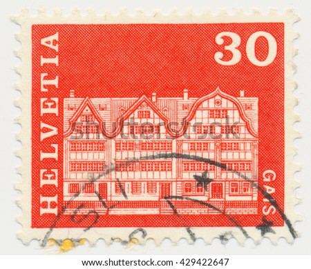 ST. PETERSBURG, RUSSIA - MAY 31, 2016: A postmark printed in SWITZERLAND, shows Gabled houses, Gais, circa 1968 - stock photo