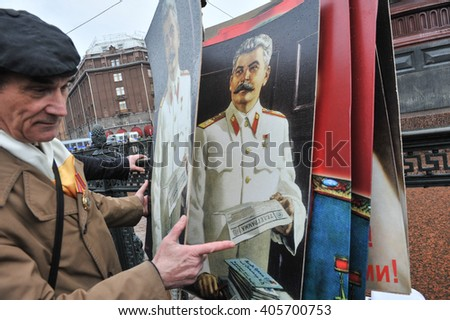 ST. PETERSBURG, RUSSIA - MAY1: During the celebration of May Day. Communist party supporters take part in a rally in May 1, 2010. Portrait of Soviet dictator Josef Stalin - stock photo
