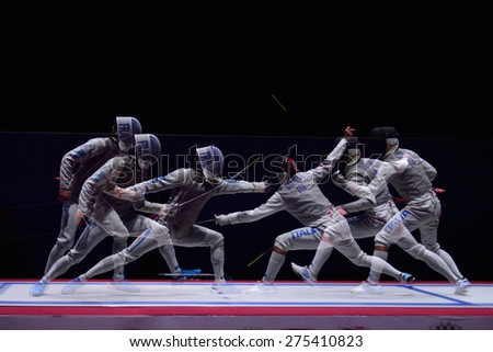 ST. PETERSBURG, RUSSIA - MAY 3, 2015: Match for 3rd place Italy vs France during 41th International fencing tournament St. Petersburg Foil. The tournament is the stage of FIE World Cup - stock photo