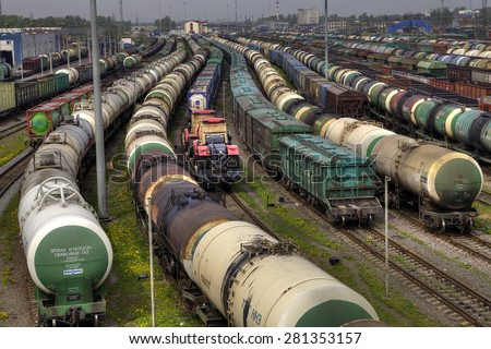 St. Petersburg, Russia - May 22, 2015: Trains of freight wagons in marshalling yard, Railway yard with a lot of railway lines and freight trains, Rail freight marshalling yard, Russian Railways. - stock photo