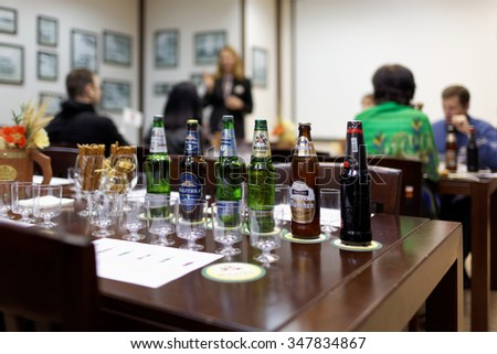 ST. PETERSBURG, RUSSIA - OCTOBER 24, 2015: Tourists during tasting session at the Baltika - St Petersburg brewery. This session is a part of the October Beer Festival celebrations - stock photo