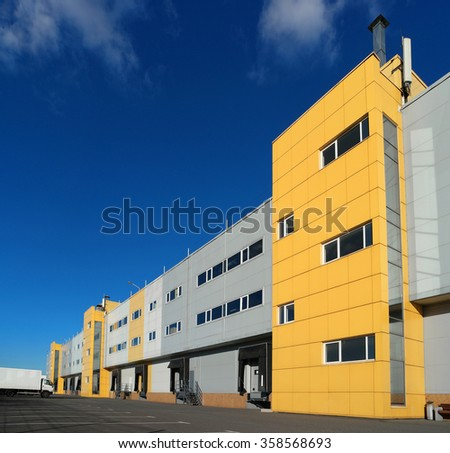 St. Petersburg, Russia - October 3, 2015: warehouses at Pulkovo Highway, Trailer docking station, painted in bright yellow - stock photo