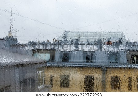 St. Petersburg, Russia, on November 3, 2014. An architectural fragment of the typical house constructed at the beginning of the XX century. A look through wet glass during a rain - stock photo