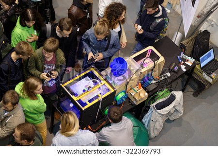 ST. PETERSBURG, RUSSIA - SEPTEMBER 19, 2015: People at the Fab Lab Polytech area during PolyFest. It's the Europe largest university festival of scientific achievements of young people - stock photo