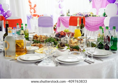 St. Petersburg, Russia, September 25, 2015: restaurant Robin. Festive Banquet hall for the newlyweds with round tables. Table setting dishes of food and Cutlery.  Design  banquet hall for guests.  - stock photo