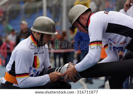 ST. PETERSBURG, RUSSIA - SEPTEMBER 9, 2015: Team Germany prepare for competitions in combat deployment during XI World Championship in Fire and Rescue Sport. First World Championship was held in 2002 - stock photo