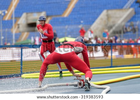 ST. PETERSBURG, RUSSIA - SEPTEMBER 9, 2015: Team Poland compete in combat deployment during XI World Championship in Fire and Rescue Sport. First World Championship was held in 2002 - stock photo
