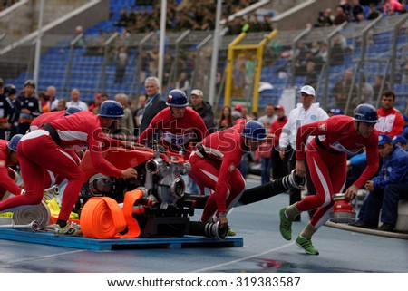 ST. PETERSBURG, RUSSIA - SEPTEMBER 9, 2015: Team Poland during competitions in combat deployment during XI World Championship in Fire and Rescue Sport. First World Championship was held in 2002 - stock photo
