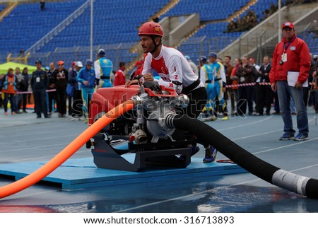 ST. PETERSBURG, RUSSIA - SEPTEMBER 9, 2015: Team Turkey during competitions in combat deployment during the XI World Championship in Fire and Rescue Sport. First World Championship was held in 2002 - stock photo