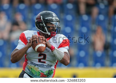 ST. POELTEN, AUSTRIA - JULY 26, 2014: QB Phillip Garcia (#2 Lions) passes the ball during Silver Bowl XVII. - stock photo