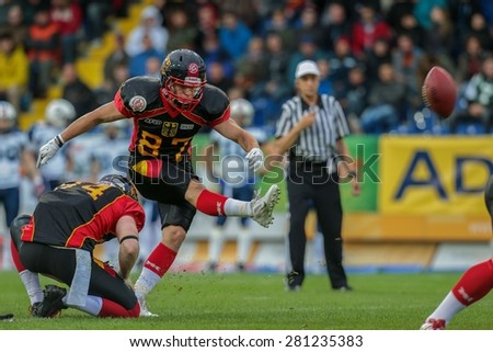 ST. POELTEN, AUSTRIA - MAY 30, 2014: K Jan Hilgenfeldt (#87 Germany) kicks a PAT in match against Finland during the EFAF European Championships 2014 in Austria. - stock photo