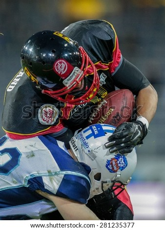 ST. POELTEN, AUSTRIA - MAY 30, 2014: WR Joseph Joyner (#9 Germany) is tackled by an opponent from Finland during the EFAF European Championships 2014 in Austria. - stock photo