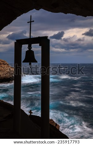 St. Stephan cave with a wavy sea view through a simple belfry  - stock photo