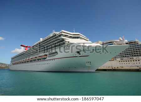 ST. THOMAS - MARCH 26: Carnival Glory cruise ship arrives in St Thomas, US Virgin Islands. on March 26, 2014 The island is one of the most popular destinations in the Caribbean. - stock photo