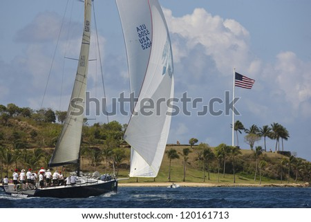 ST. THOMAS, USVI - MARCH 26: TP 52 Interlodge races by Great Island in 2010 International Rolex Regatta in St. Thomas, USVI on March 26, 2010. - stock photo