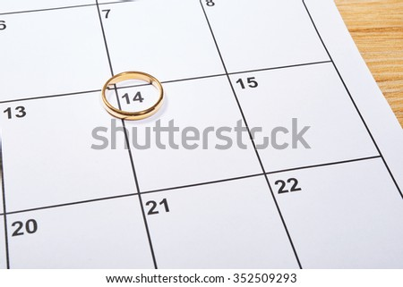 St Valentine day in agenda with wedding ring - stock photo