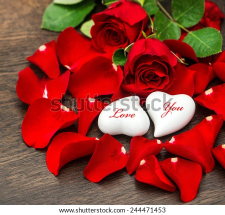 St. Valentine's Day decoration red roses and two hearts. Holidays background. Sample text Love You - stock photo