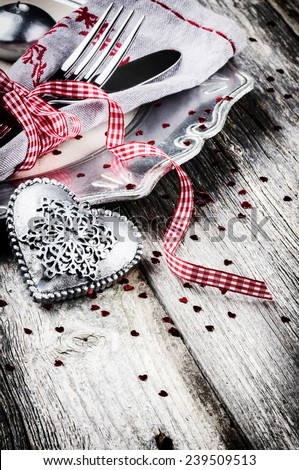 St Valentine's table setting with decorative heart  - stock photo
