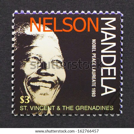 ST. VINCENT AND THE GRENADINES - CIRCA 2006: postage stamp printed in Saint Vincent and The Grenadines showing an image of Nobel Peace prize winner Nelson Mandela, circa 2006.  - stock photo