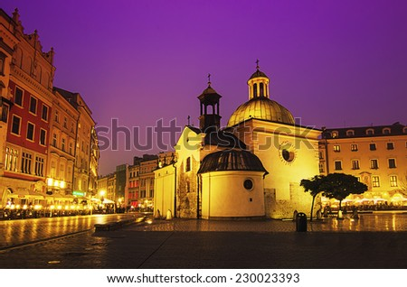 St. Wojciech church at main Cracow square at night with purple sky - stock photo