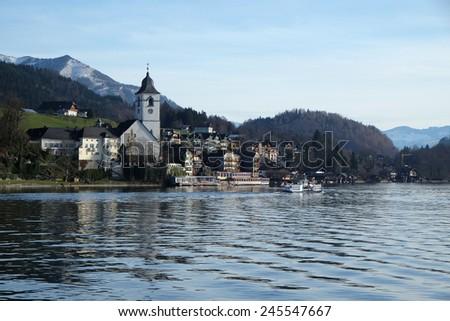 ST. WOLFGANG, AUSTRIA - DECEMBER 14: St. Wolfgang village waterfront at Wolfgangsee lake in Austria on December 14, 2014. - stock photo