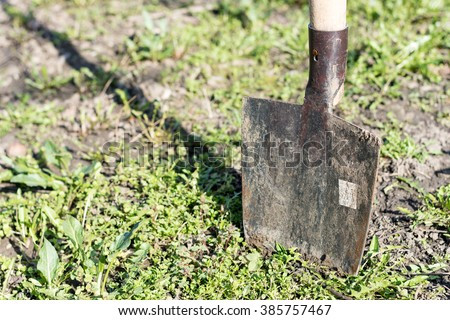 Stabbed shovel into the ground. - stock photo