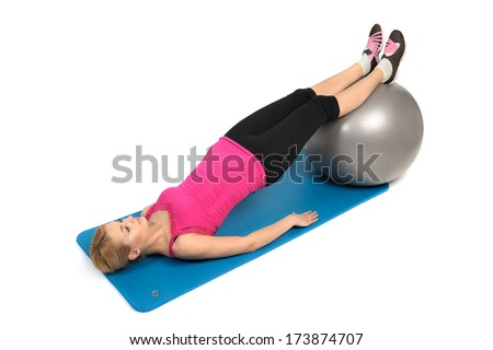 Stability Fitness Ball Leg Curls, Female Butt Exercise, phase 2 of 2 - stock photo