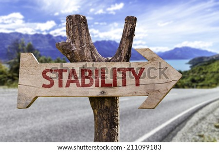 Stability wooden sign with a street background  - stock photo