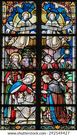 STABROEK, BELGIUM - JUNE 27, 2015: Stained glass window depicting a Nativity Scene at Christmas in the Church of Stabroek, Belgium. - stock photo