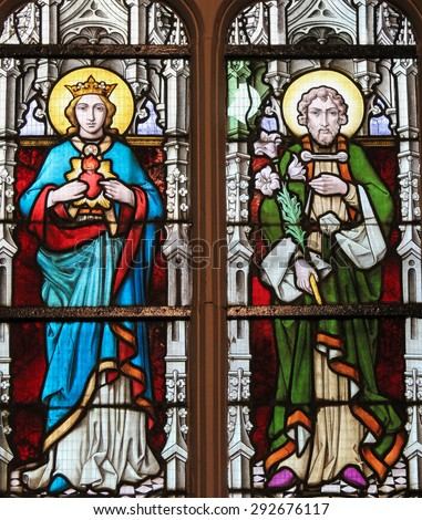 STABROEK, BELGIUM - JUNE 27, 2015: Stained glass window depicting Mother Mary and Saint Joseph, parents of Jesus Christ, in the Church of Stabroek, Belgium. - stock photo