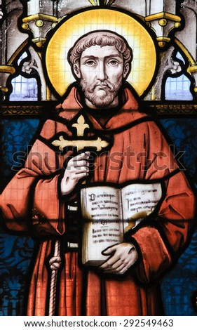 STABROEK, BELGIUM - JUNE 27, 2015: Stained glass window depicting Saint Francis of Assisi in the Church of Stabroek, Belgium. - stock photo