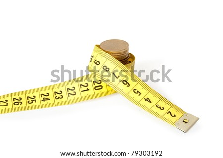 stack coins with tape measuring - stock photo