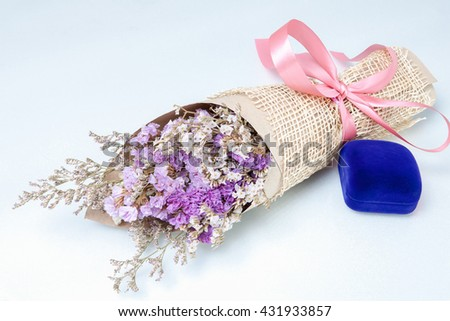 Stack Image : Bouquet of flower with blue  jewelry boxes /lavender flower purple color  isolated on white background - stock photo
