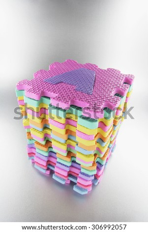 Stack of Alphabet Puzzles - stock photo