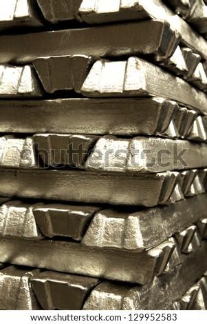 Stack of aluminum ingot arrangement in warehouse - stock photo