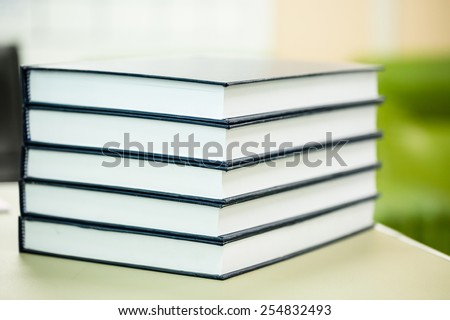 Stack of big blue textbooks - stock photo