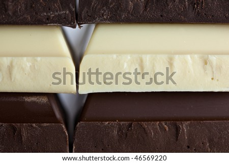 Stack of Black, Brown and White Chocolate isolated on white background - stock photo