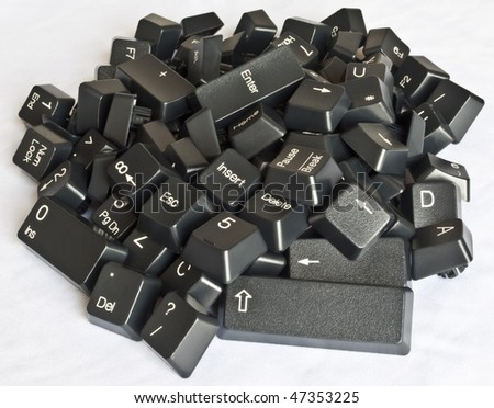 Stack of  black computer keyboard keys on a white background - stock photo