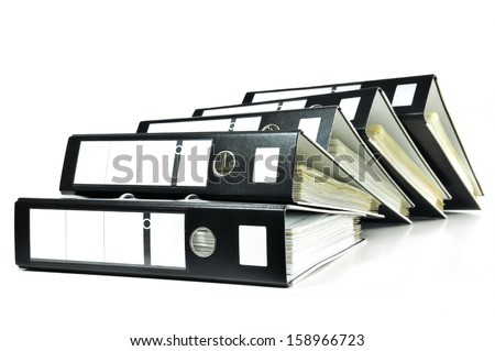 Stack of black ring binders with documents - stock photo